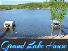 Large house on Grand Lake in eastern Oklahoma will be headquarters for your family\'s memorable vacation! The two story house sits on a hillside overlooking the water, with a large deck, perfect for enjoying the view. The deck gets morning sun and afternoon shade. Just below the deck is a shaded patio with another grill and a picnic table.